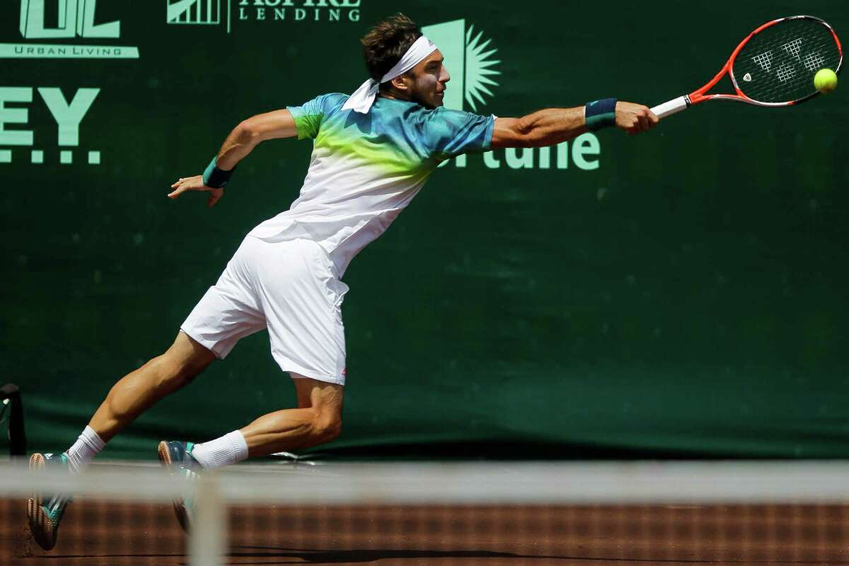 Juan Monaco hits the ball back to Jack Sock during the singles final of the U.S. Men's Clay Court Championship tennis tournament, Sunday, April 10, 2016 in Houston. Monaco defeated Sock 3-6, 6-3, 7-5 to win the championship. (Michael Ciaglo/Houston Chronicle via AP)