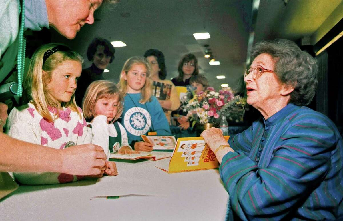 In this April 19, 1998 photo, Beverly Cleary signs books at the Monterey Bay Book Festival in Monterey, Calif. (Vern Fisher/Monterey Herald via AP)