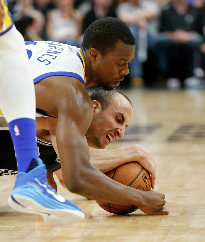 Spurs' Manu Ginobili (20) struggles to keep possession of a loose ball against Golden State Warriors' Harrison Barnes (40) at the AT&T Center on Sunday, Apr. 10, 2016. (Kin Man Hui/San Antonio Express-News) Photo: Kin Man Hui, Staff / San Antonio Express-News / ©2016 San Antonio Express-News