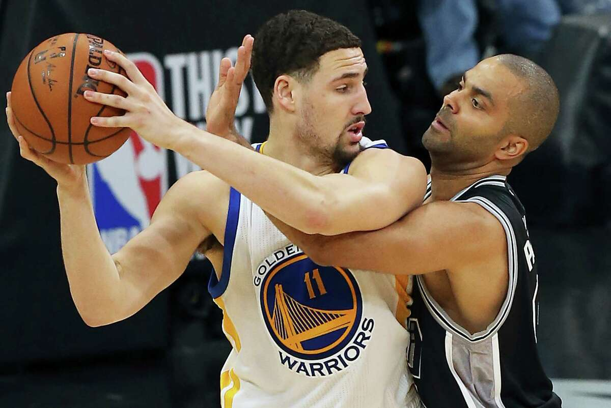 Tony Parker pressures Klay Thompson in the second half as the Spurs host Golden State at the AT&T Center on April 10, 2016.