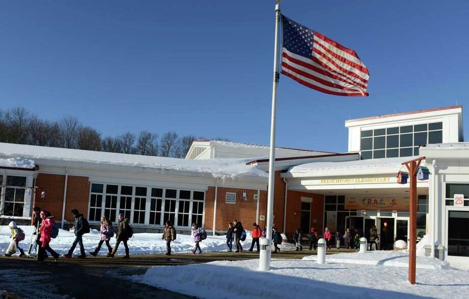 Students file out of Frenchtown Elementary School, in Trumbull, in a photo taken in February 2015. Frenchtown Elementary is one of five schools in Trumbull where solar panels will be installed to supply power. Photo: Autumn Driscoll / Hearst Connecticut File Photo / Connecticut Post