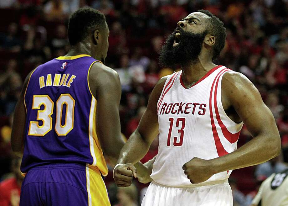 Rockets guard James Harden is pumped up after scoring two of his 40 points in the first half of the Rockets' victory over the Lakers on Sunday at Toyota Center. Harden also had 13 assists for his fifth 40-point, 10-assist performance of the season. Photo: James Nielsen, Staff / © 2016  Houston Chronicle