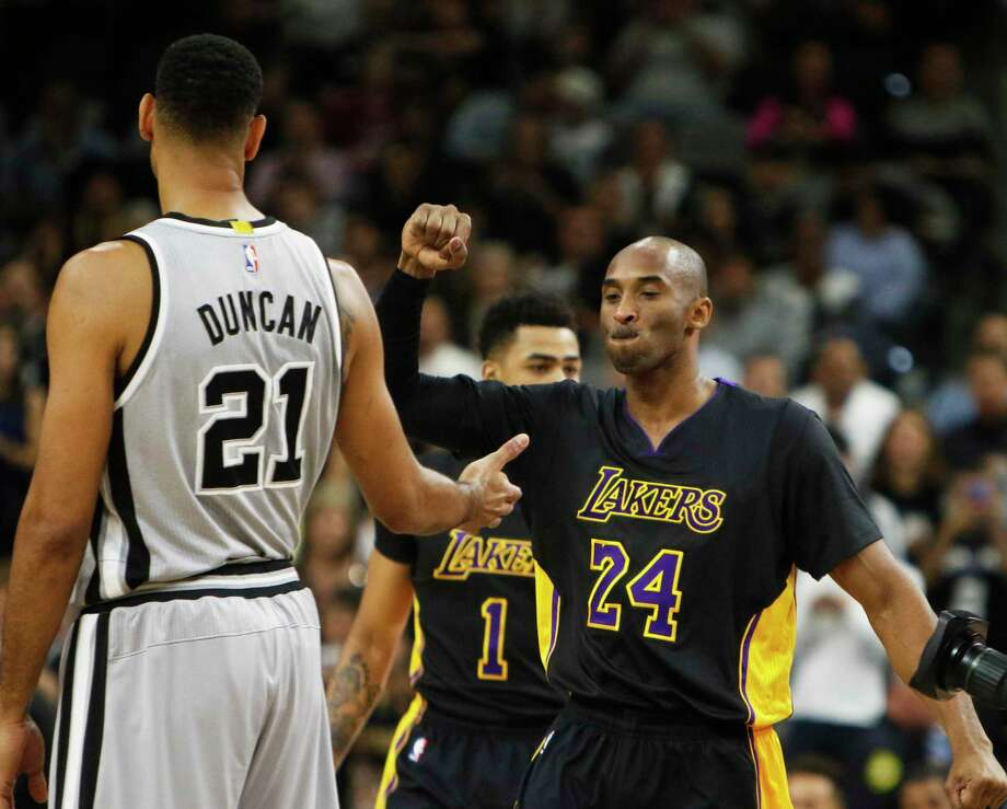 Kobe Bryant of the Los Angeles Lakers greets Tim Duncan of the San Antonio Spurs before Bryant's final game at the AT&T Center on Dec. 11, 2015 in San Antonio. Photo: Ronald Cortes /Getty Images / 2015 Getty Images