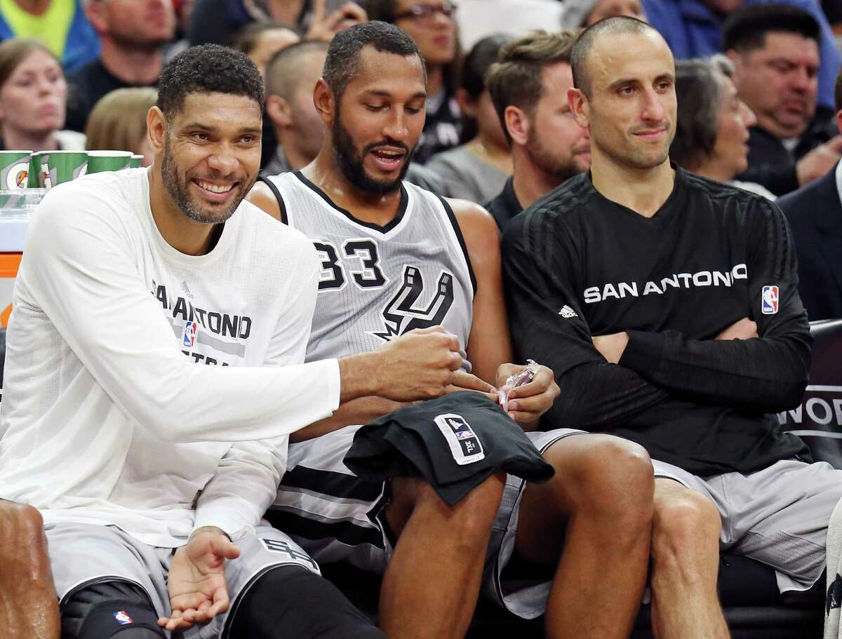 Spurs' Tim Duncan (from left) jokes with teammates Boris Diaw and Manu Ginobili while on the bench during second half action against the Boston Celtics on Dec. 5, 2015 at the AT&T Center.