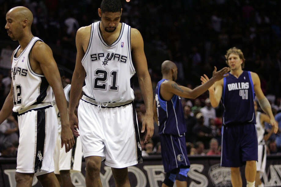 Spurs' Bruce Bowen and Tim Duncan are unhappy with their situation during overtime while Mavericks' Jerry Stackhouse and Dirk Nowitzki celebrate theirs at the AT&T Center in San Antonio on May 22, 2006 during Game 7 of the NBA Western Conference semifinals. Photo: Jerry Lara /San Antonio Express-News / © San Antonio Express-News