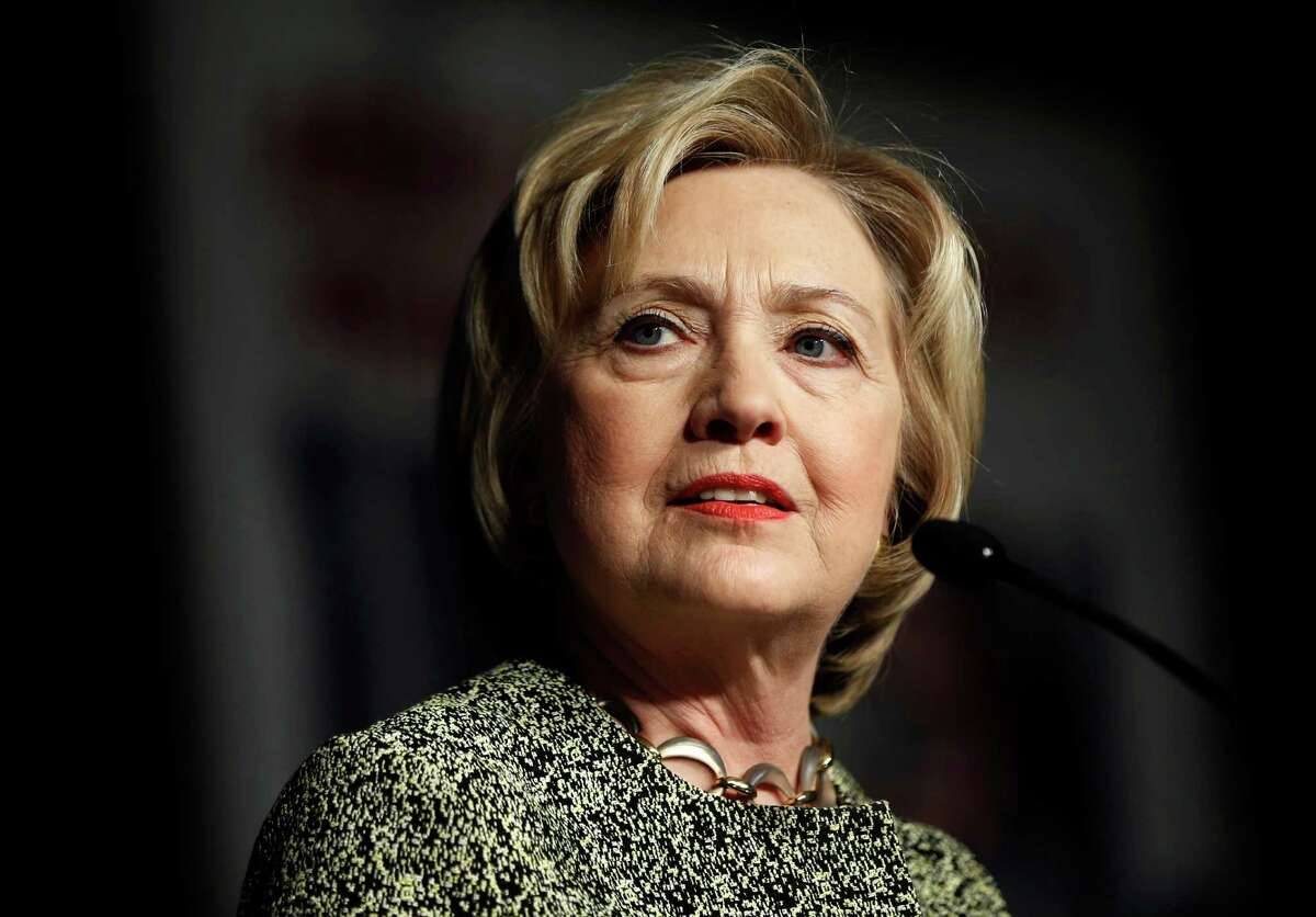 In this April 6, 2016, photo, Democratic presidential candidate Hillary Clinton speaks at the Pennsylvania AFL-CIO Convention in Philadelphia. A new Associated Press-GfK poll finds that Americans trust Democratic presidential front-runner Clinton more than Republican leader Donald Trump to handle a wide range of issues, from immigration to health care to nominating Supreme Court justices.