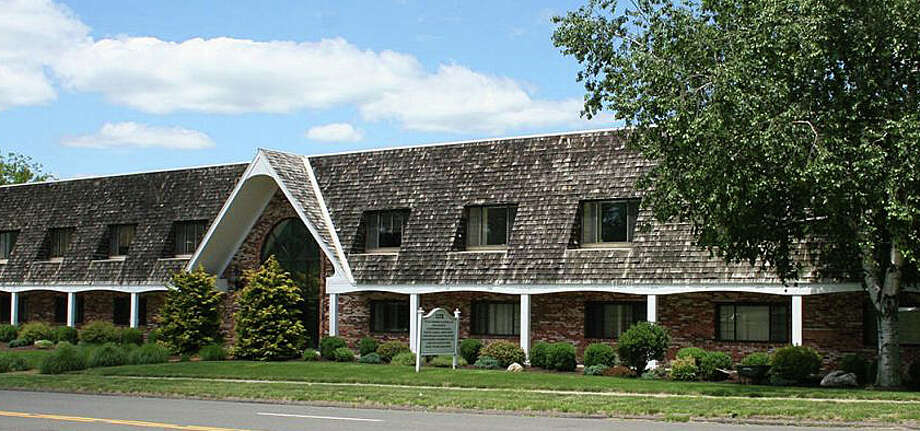 The building at 1177 Post East, previously owned by the Kowalsky family, would be revdeveloped as part of a 94-unit residential complex by the new owners under plans filed with town land-use officials. Photo: Contributed / Contributed Photo / Westport News