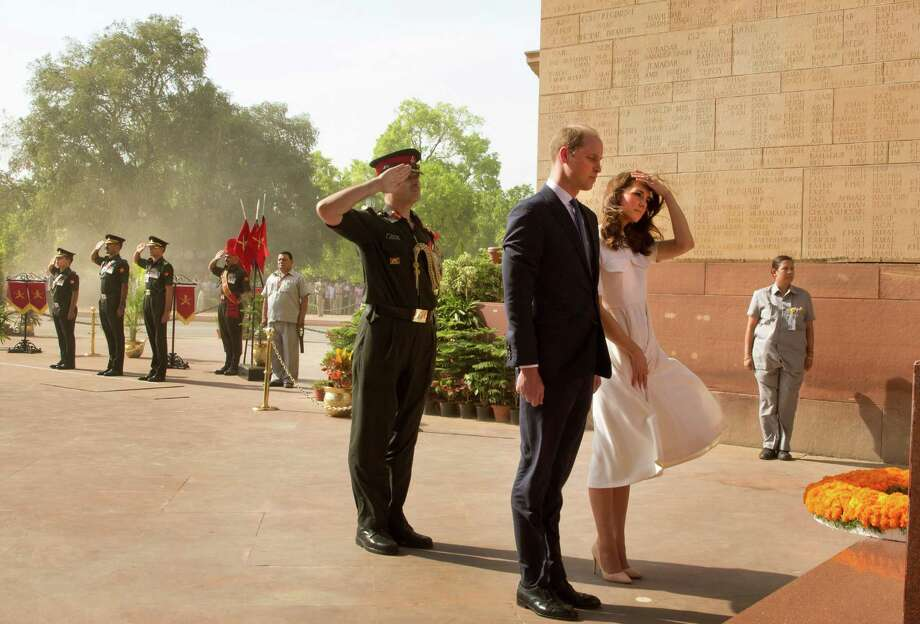 Britain's Prince William, along with his wife Kate, the Duchess of Cambridge, right, pay their tributes at the India Gate war memorial, in the memory of the soldiers from Indian regiments who served in World War I, in New Delhi, India, Monday, April 11, 2016. (Manish Swarup/Pool Photo via AP) Photo: Manish Swarup, AP / POOL AP
