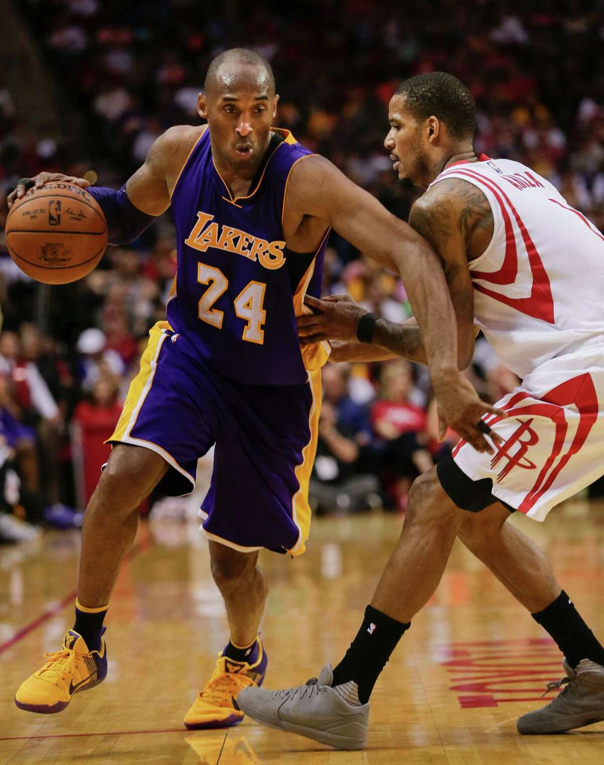 HOUSTON, TEXAS - APRIL 10: Kobe Bryant #24 of the Los Angeles Lakers drives around Trevor Ariza #1 of the Houston Rockets in the fourth quarter at Toyota Center on April 10, 2016 in Houston, Texas.