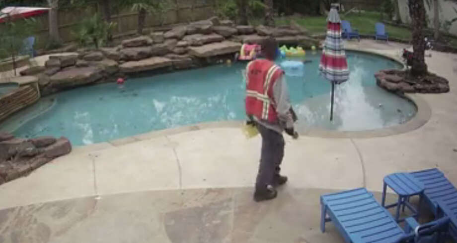 A shocking surveillance video that surfaced Sunday shows a man who identified himself as a CenterPoint Energy worker beating a Kingwood family's dogs with a pipe wrench. Photo: Mike Wilcox