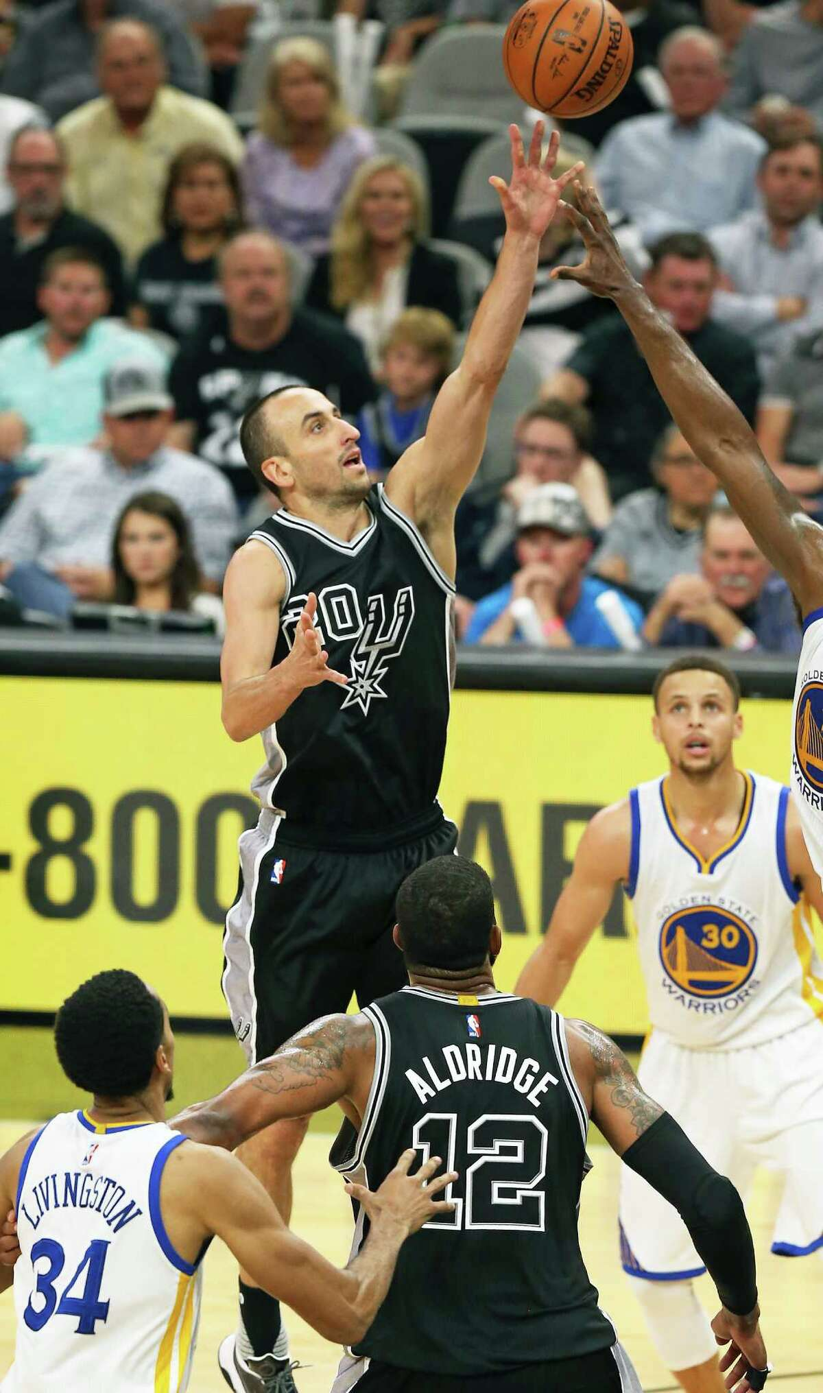 Manu Ginobili hoists a jumper in the second half as the Spurs host Golden State at the AT&T Center on April 10, 2016.