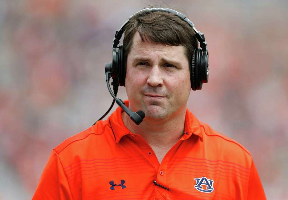 FILE - In this April 18, 2015, file photo, Auburn defensive coordinator Will Muschamp walks around the football field in the first quarter of their spring NCAA college football game in Auburn, Ala. A person with direct knowledge of the decision says Muschamp has agreed to become South Carolina's next head football coach, and he could be formally introduced as early as Monday, Dec. 7, 2015. (AP Photo/Brynn Anderson, File) Photo: Brynn Anderson, Associated Press / AP