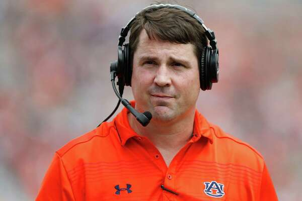 FILE - In this April 18, 2015, file photo, Auburn defensive coordinator Will Muschamp walks around the football field in the first quarter of their spring NCAA college football game in Auburn, Ala. A person with direct knowledge of the decision says Muschamp has agreed to become South Carolina's next head football coach, and he could be formally introduced as early as Monday, Dec. 7, 2015. (AP Photo/Brynn Anderson, File)