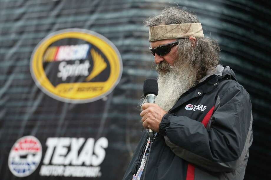 FORT WORTH, TEXAS - APRIL 09:  Duck Dynasty's Phil Robertson gives the invocation prior to the NASCAR Sprint Cup Series Duck Commander 500 at Texas Motor Speedway on April 9, 2016 in Fort Worth, Texas. Photo: Chris Graythen, Getty Images / 2016 Getty Images