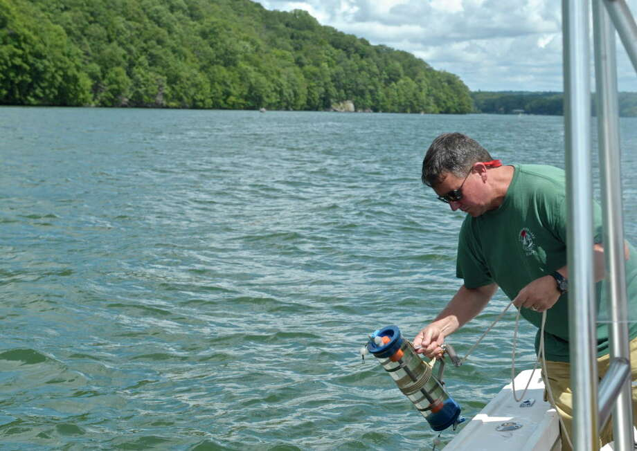 Larry Marsicano, executive director of the Candlewood Lake Authority, tests for blue-green algae in Candlewood Lake last August in this file photo. Photo: H John Voorhees III / Hearst Connecticut Media / The News-Times