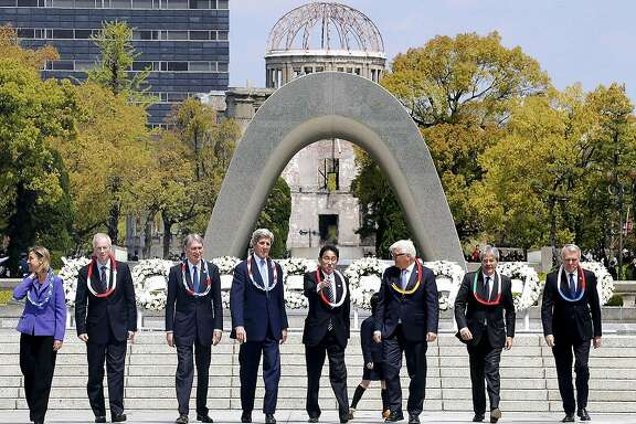 Secretary of State John Kerry (fourth from left) and other foreign ministers from the Group of Seven major countries visit the Hiroshima Peace Memorial Park on Monday morning to lay wreaths at a cenotaph for victims of the 1945 U.S. atomic bombing of the Japanese city. From left: Federica Mogherini, high representative of the European Union for foreign affairs and security policy, and G-7 foreign ministers � Stephane Dion of Canada, Philip Hammond of Britain, Kerry, Fumio Kishida of Japan, Frank-Walter Steinmeier of Germany, Paolo Gentiloni of Italy and Jean-Marc Ayrault of France. MUST CREDIT: Japan News - Yomiuri Shimbun.