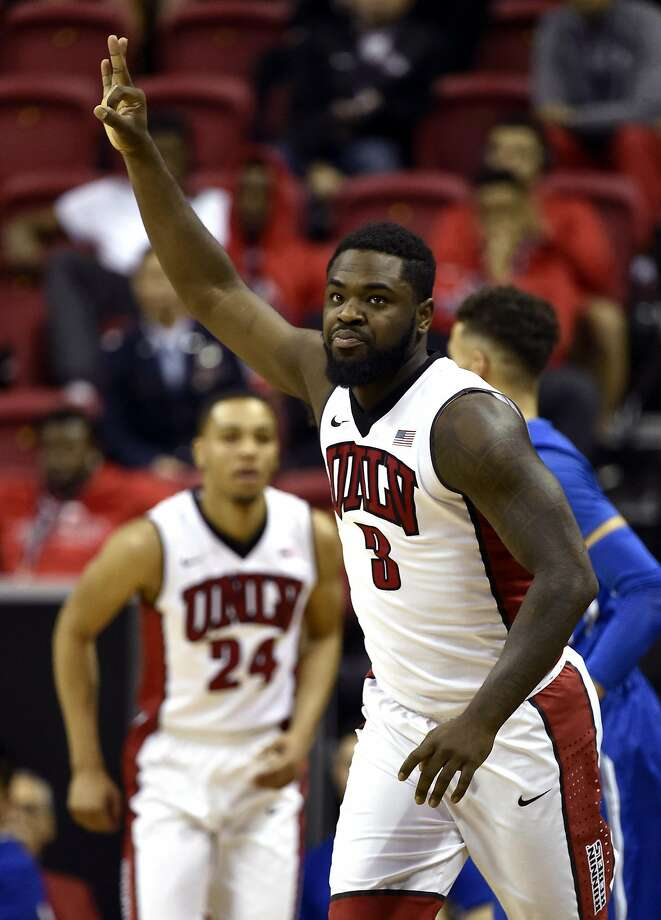 UNLV's Jordan Cornish (3) gestures after making a three-point basket during the first half of an NCAA college basketball game against Air Force at the Mountain West Conference men's tournament Wednesday, March 9, 2016, in Las Vegas. (AP Photo/David Becker) Photo: David Becker, AP