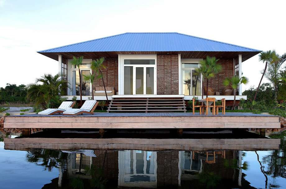 Bay Area residents Rhanee Palma and Claudio Palma purchased this waterfront cottage at the Itz�ana Resort & Residences in Belize. The resort features 39 luxury cottages and villas set between the Caribbean Sea and Placencia Lagoon. Photo: Eileen Chiang