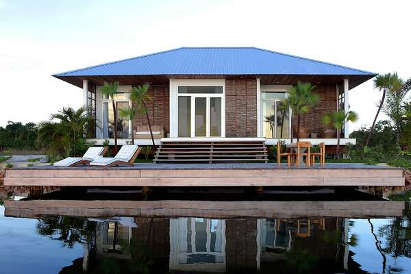 Bay Area residents Rhanee Palma and Claudio Palma purchased this waterfront cottage at the Itz�ana Resort & Residences in Belize. The resort features 39 luxury cottages and villas set between the Caribbean Sea and Placencia Lagoon.