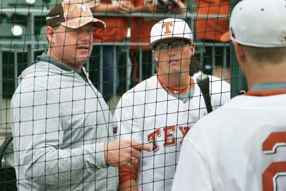 Roger Clemens talks with his sons Kacy (center) and Kody after the game as Texas loses to TCU 9-5 in college baseball at Disch-Falk Field in Austin on March 26, 2016.