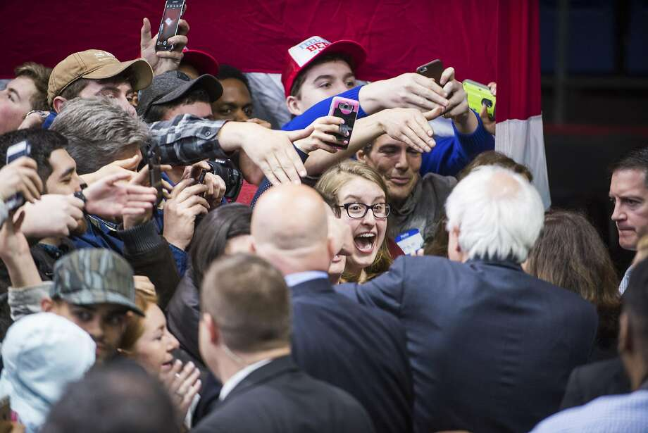 Democratic presidential candidate Bernie Sanders greets supporters in Binghamton, N.Y. He knocked Clinton's record on fracking, the drilling method reviled by environmentalists. Photo: GABRIELLE PLUCKNETTE, NYT