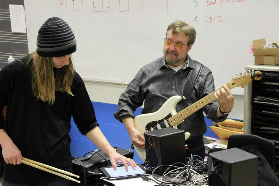 Joe Bouchard, founding member of Blue Oyster Cult, teaches an after-school program for young musicians who want to play in a band in Washington, Conn. Photo: Contributed Photo