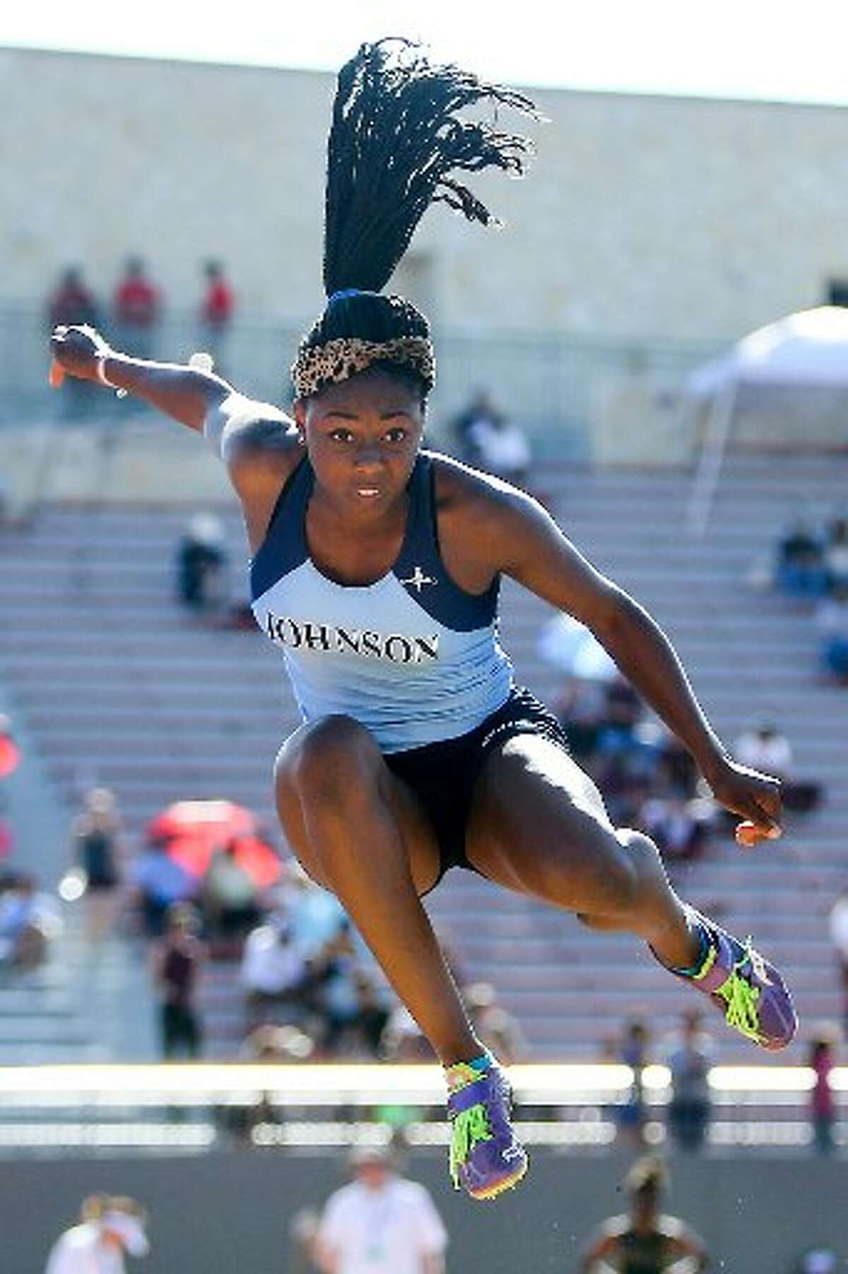 Johnsons' Mikayla Jordan jumps in the 6A Long Jump during the Region IV-5A and Region IV-6A Track and Field meet at Alamo Stadium on Friday, May 1, 2015. Jordan won the event with a leap of 17 feet, 11 3/4 inches.