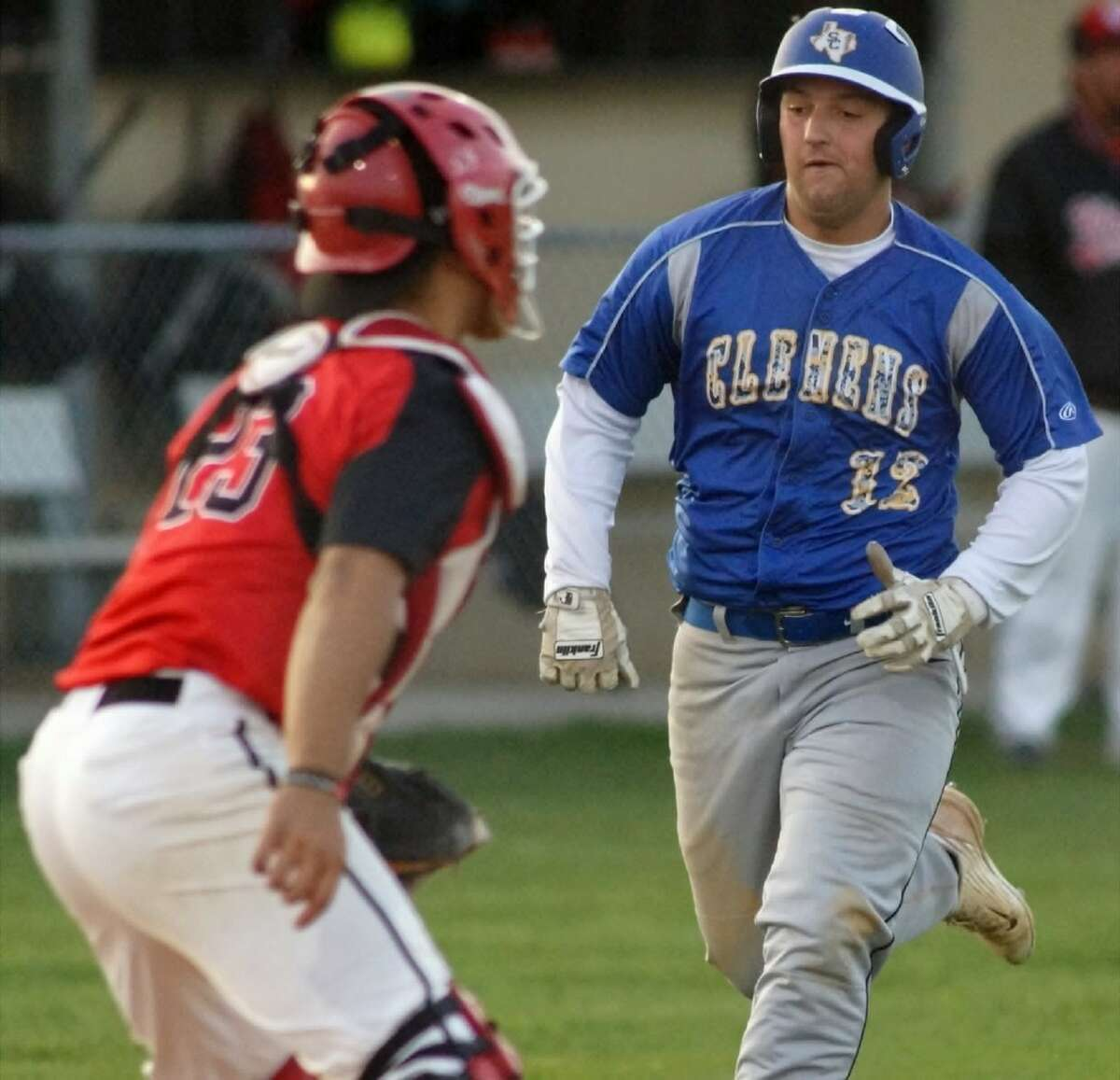 Clemens' Cody Sasser (12) scores from first base on a Tyler Smith double in the second inning of Clemens' 11-2 win Friday at Wagner.