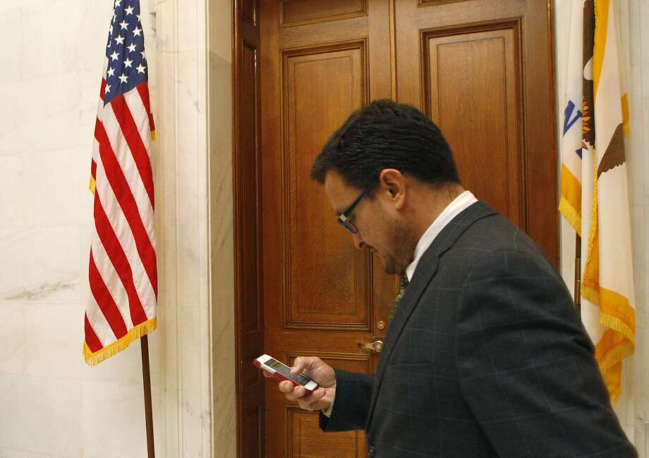 Supervisor David Campos checking his phone as he works on letting others know of his amendment in San Francisco, Calif., on Monday, January 14, 2013.  He will be introducing a charter amendment tomorrow that would rename San Francisco International Airport as Harvey Milk San Francisco International Airport . Photo: Liz Hafalia, The Chronicle