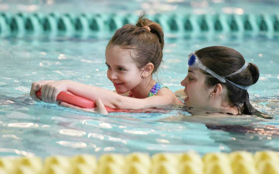 Maria Sucic, 5, of Greenwich, floats with help from youth development instructor Ashley Culver during a swim lesson at the ZAC Foundation swim camp at the Boys and Girls Club of Greenwich in Greenwich, Conn. Monday, April 11, 2016. More than 100 Greenwich kids are participating in the week-long ZAC Foundation swim camp at the Boys and Girls Club where they will spend time swimming in the pool while also learning important lessons about swimming safety. Karen and Brian Cohn founded The ZAC Foundation in 2008 in honor of their 6-year-old son, Zachary, who died after his arm became entrapped in a pool drain. Photo: Tyler Sizemore / Hearst Connecticut Media / Greenwich Time