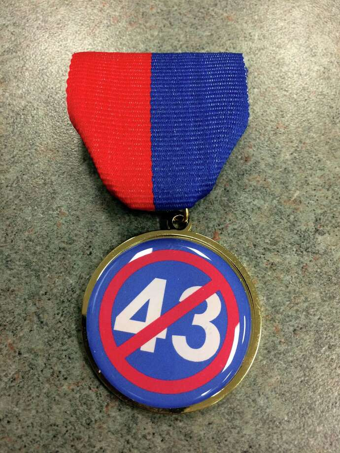 Arthur Lindley, the sergeant at arms for the San Antonio Police Officers Association, has purchased Fiesta medals this year attacking the 43 police officers who voted in favor of Police Chief William McManus in the union's no-confidence vote last month.