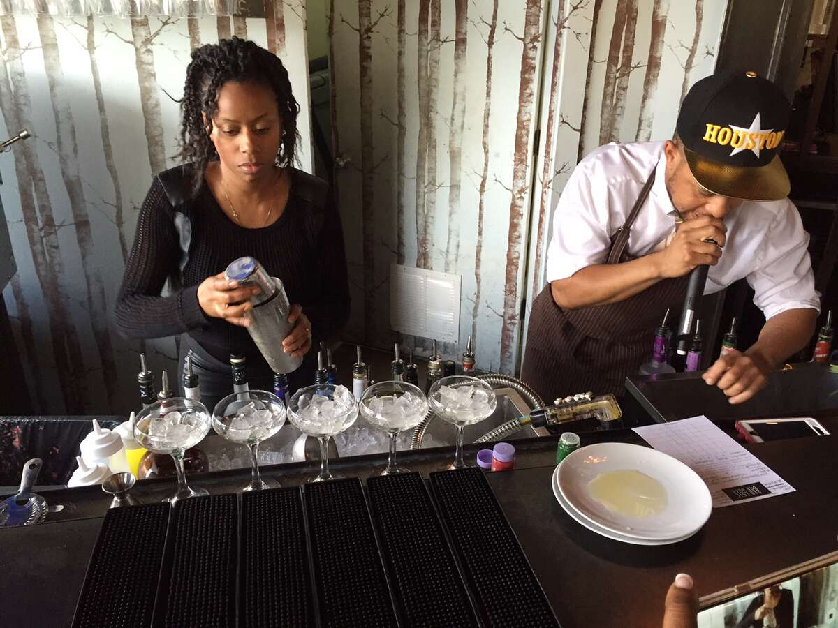 A competing bartender finishes her drink for Black Restaurant Week's Power of the Palette bartending competition on Saturday, April 9, 2016.