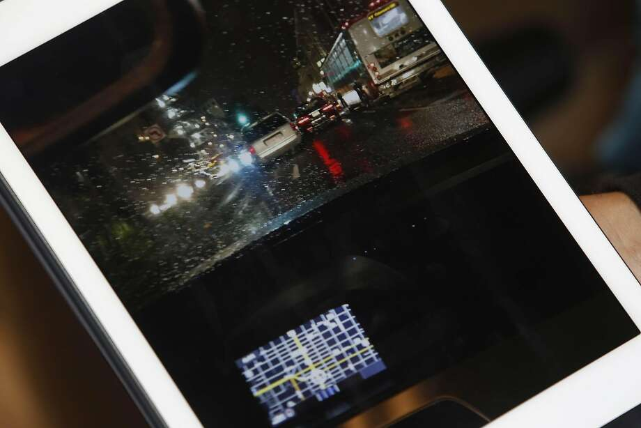 Jason West of San Francisco displays a photo taken on  March 12 when West says he was a passenger in an Uber that was involved in a road rage incident on Monday, April 11, 2016 in San Francisco, California. Photo: Lea Suzuki, The Chronicle