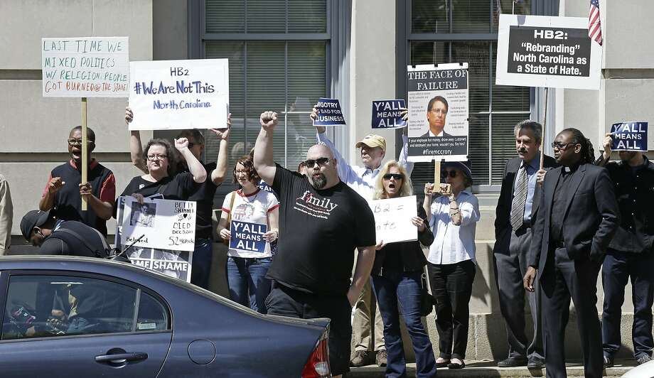 Opponents of House Bill 2 protest across the street from the North Carolina State Capitol in Raleigh, N.C., Monday, April 11, 2016 during a rally in support of the law that blocks rules allowing transgender people to use the bathroom aligned with their gender identity. (AP Photo/Gerry Broome) Photo: Gerry Broome, AP