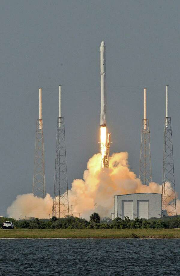 The Falcon 9 rocket slated to take off next week has flown before, marking the first time SpaceX will refly one of the 14-story-tall boosters it recovered from past missions. Shown here is its April 8 launch. Photo: AFP /Getty Images /File Photo / AFP or Licensors