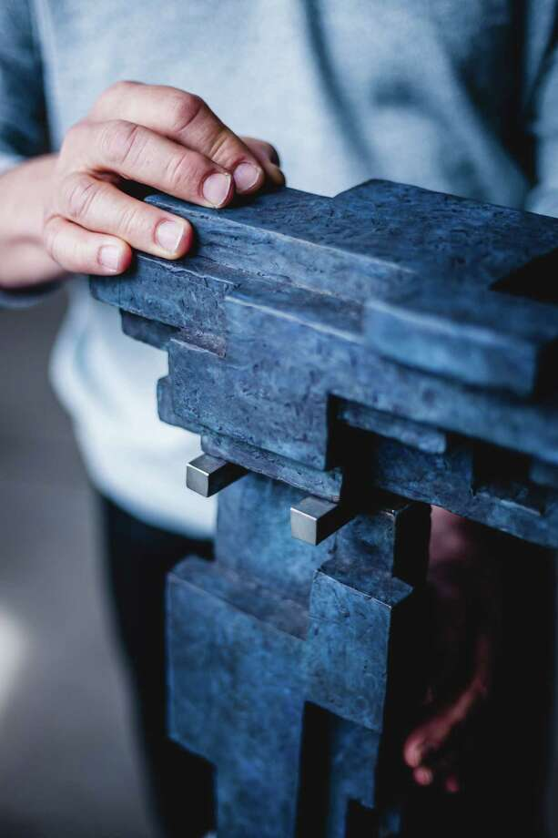 Don Gummer's rich blue petina clay maquette of what would later be turned into a larger aluminum piece. Photo: Christopher Setter / For Hearst Connecticut Media / Christopher Setter  Connecticut Post Freelance