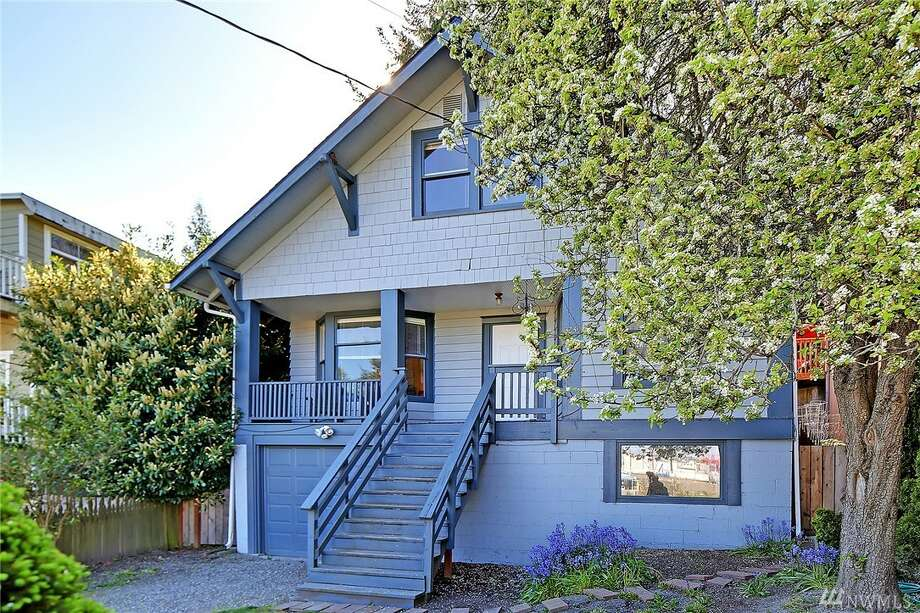 The first home, 3239 30th Ave. S.W., is listed for $450,000. The four bedroom, two bathroom home spans over 2,800 square feet and overlooks the Port of Seattle.