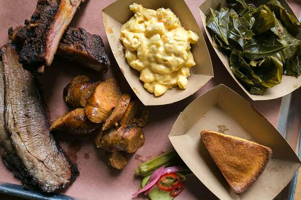 The 3 meat platter with brisket, ribs, hot links, greens, mac and cheese and cornbread at Black Bark BBQ in S.F.