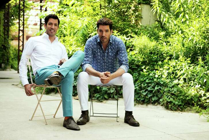 """Drew Scott, left, is a real estate agent and Jonathan Scott is a licensed contractor. The twins find fixer-uppers and turn them into dream homes for couples on HGTV's """"Property Brothers."""""""