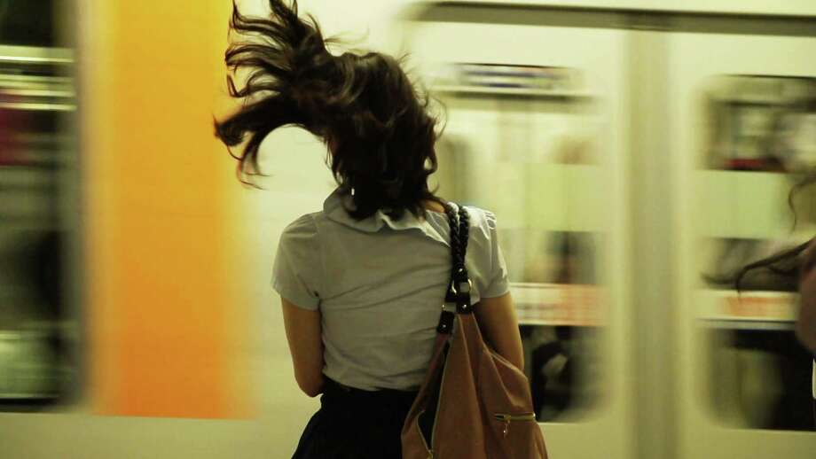 """A girl waits on a Tokyo subway platform in """"In Pursuit of Silence."""""""