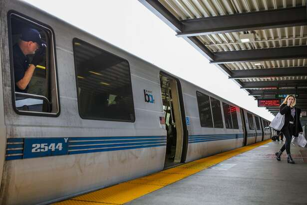 A BART conductor makes an announcement and looks to see that all passengers have boarded the train at the Daly City BART stop in Daly City, California, on Monday, April 11, 2016.