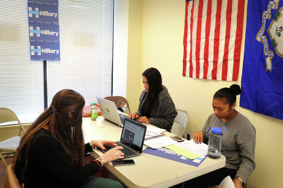 From left, Alexandra Heller of Westport, Kayla Reasco of New Britain and Danielle O'Bannner of Oxford work in the new Hillary Clinton headquarters in downtown Bridgeport, Conn. April 11, 2016. Photo: Ned Gerard