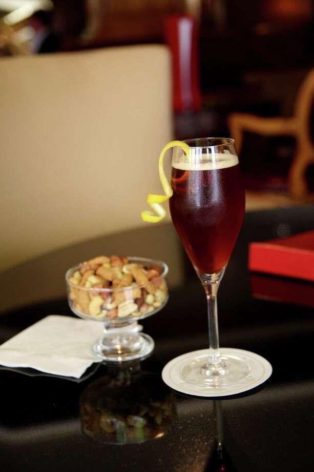 Death and Taxes is cognac, Cointreau and a balsamic vinegar and fig shrub. Photo: Paula Murphy