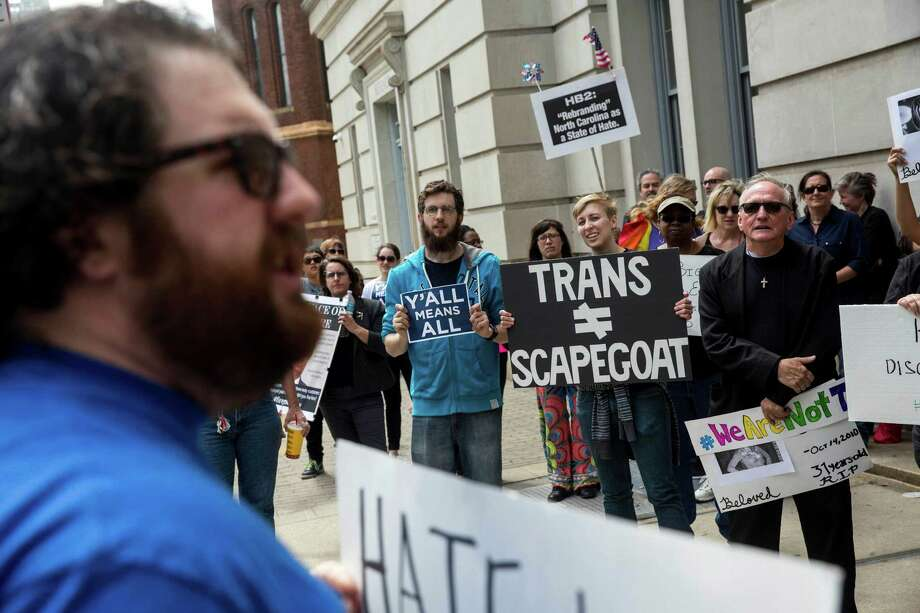 Opponents of a new state law that restricts transgender bathroom use and pre-empts local governments from creating their own anti-discrimination policies at a counter-rally, across the street from a rally for proponents of the new law, outside the the North Carolina State Capitol in Raleigh, April 11, 2016. (Ray Whitehouse/The New York Times) Photo: RAY WHITEHOUSE, STR / NYTNS