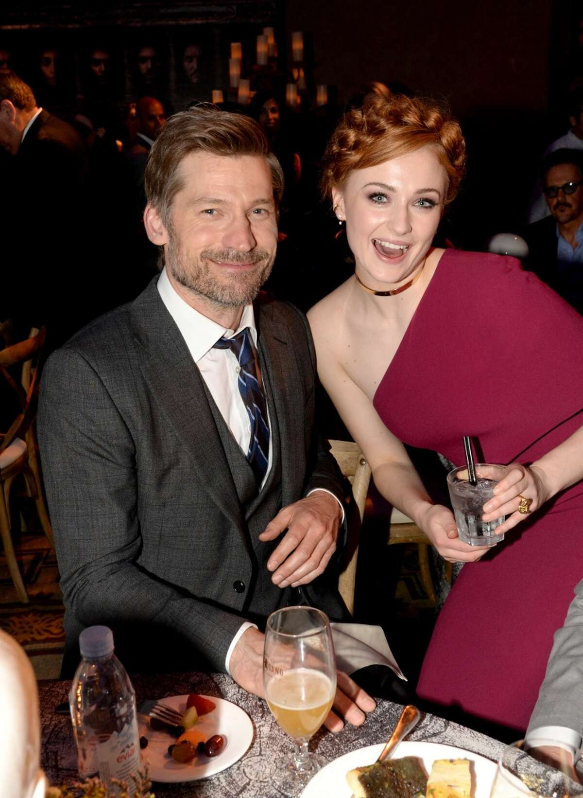 Actors Nikolaj Coster-Waldau (left) and Sophie Turner attend the after-party at the premiere for the sixth season of HBO's