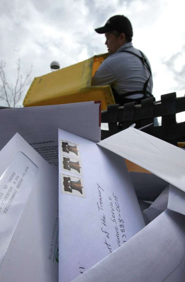 The federal income-tax filing deadline is rapidly approaching. People who are mailing their tax forms have until Monday to get their return postmarked. Photo: Associated Press File Photo / AP