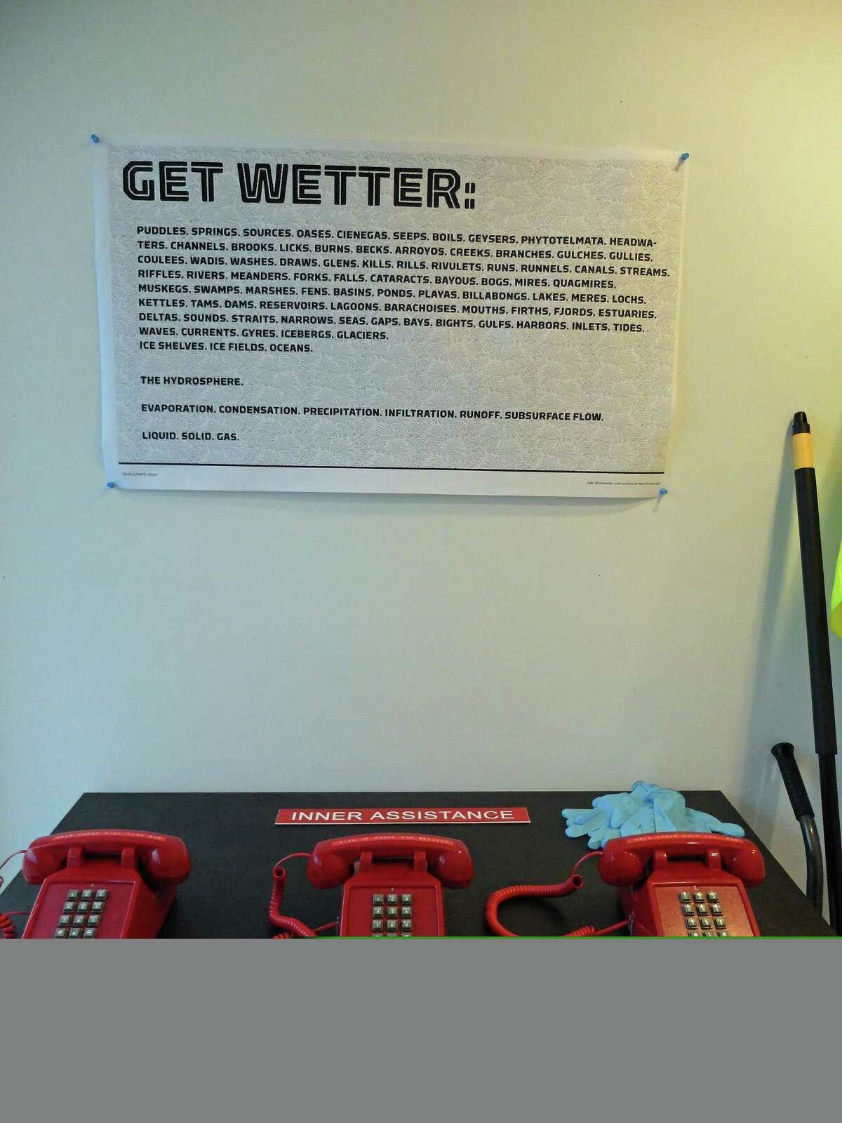 """Official-looking """"phones"""" in Marina Zurkow's installation """"DearClimate"""" at Rice University, which resembles a FEMA trailer, connect visitors to recorded messages."""