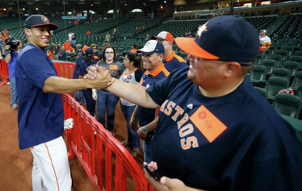 Houston Astros shortstop Carlos Correa (1) greets a family friend during batting practice before the start of an MLB game at Minute Maid ParkonMonday, April 11, 2016, inHouston.