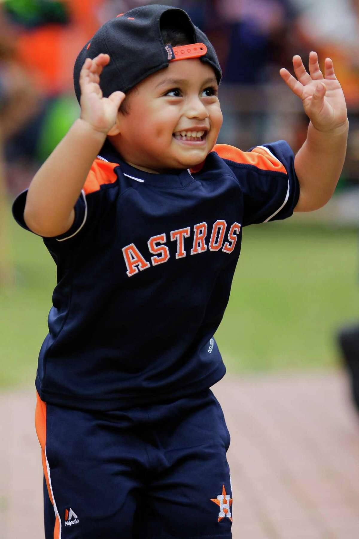 Nathaniel Munoz, 2, prepares to high five his mother after playing corn hole during the Opening Day Street Fest as the Astros open their season at home against the Royals at Minute Maid ParkonMonday, April 11, 2016 in Houston.