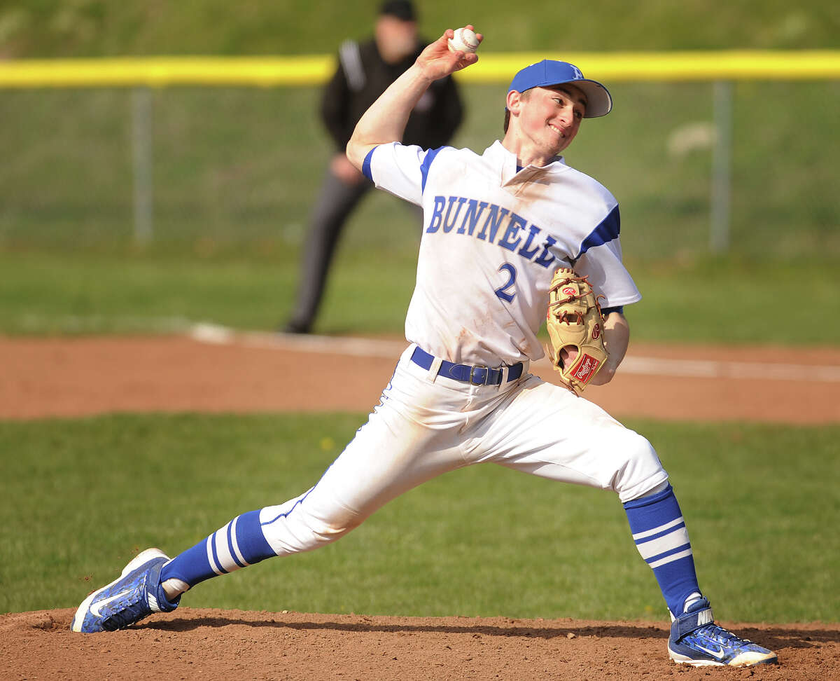 Bunnell pitcher Adam Wojenski delivers to the plate during the 3rd inning of the Bulldogs' home baseball game with Masuk at Bunnell High School in Stratford, Conn. on Monday, April 11, 2016.